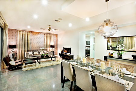 diningroom: Luxury living room and dining area with hanging lights including chairs and tables beside the television near the carpet and door entrance