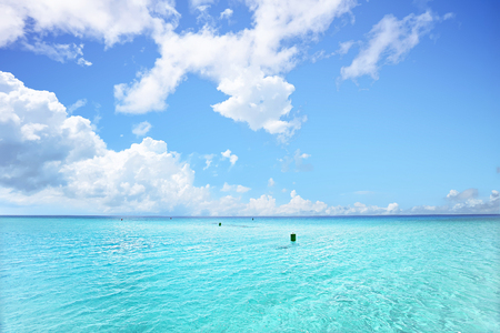 Shiny and bright clouds in the blue sky with white color, giving the light with sunlight, the clear and light water in the sea area