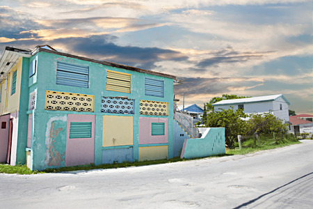 colorful houses and roads among trees under blue sky including old  homes and like strange city with a residential area Stock Photo