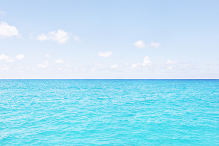 Colorful sea area with blue sky, sunshine arround the area, weather is good, white clouds are beautiful, luxury ships design, clear water view
