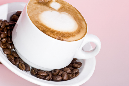 Pure coffee mixed fresh milk mug, white color cup and background, colorized photograph including perfect lights, very tasty hot drink of luxury house.