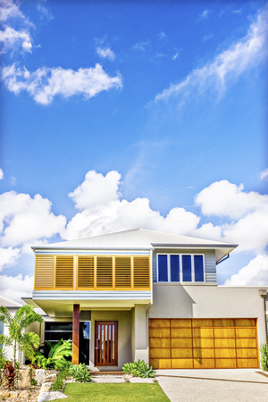 Home design also luxury look, sky is beautiful from blue color, trees and grass on ground, there is a small road infront of house, perfect lightning, modern apartment in city.
