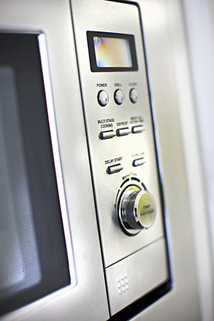 Modern oven control panel close up with buttons and knob close up of a modern kitchen Imagens