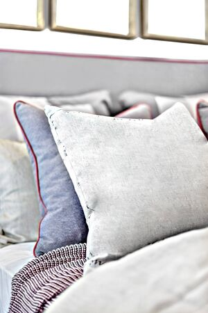 Pillows on the bed closeup with the background blurred in a modern house