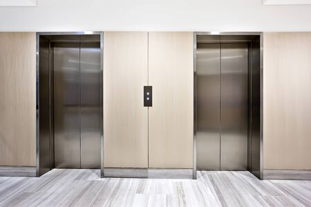 Modern silver elevator in a luxury building with door closed
