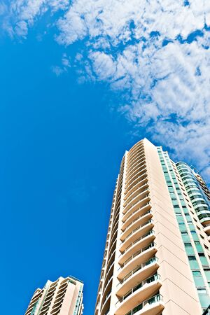 Modern business building with blue sky and white clouds from Brisbane City, Queensland, Australia. 写真素材