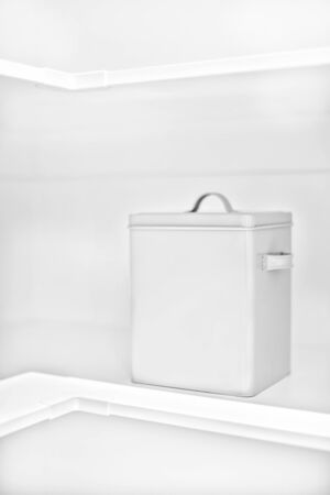 Modern laundry basket in white rack closes up in a luxury room isolated, very clean place also perfect lightning.