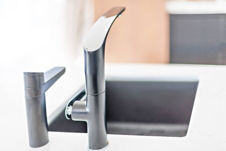Artsy kitchen taps on the kitchen counter basin