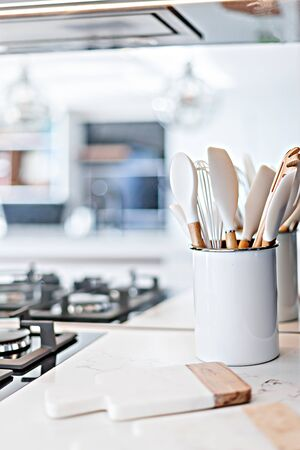Basic kitchen tools placed near the gas hob 스톡 콘텐츠