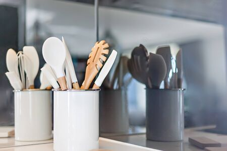 Clean kitchen tools with their reflection on the back wall