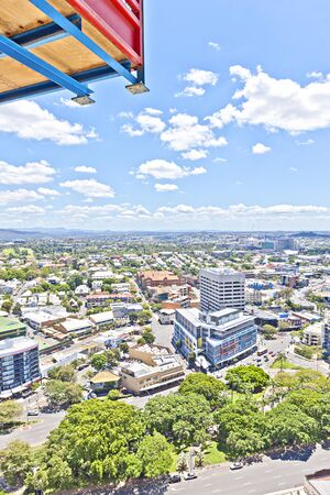 Blue sky view with business town and green trees, luxurious city buildings with technology and natural view, luxurious city with business buildings near green trees, trees are  attractive with sun shine, roads near city view.