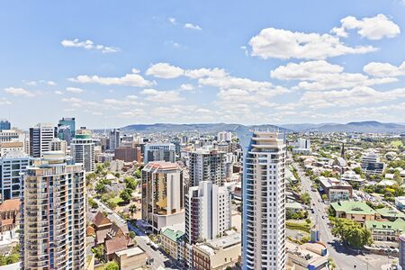 Full city  building designs and trees, green plants near road,  tree gardens of luxury place, business town including latest designing technology, sky has white clouds, australia natural looking view. Stockfoto
