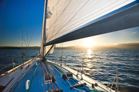 Yacht and sunset with mountains at the horizon Reklamní fotografie