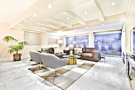Comfortable room with luxury furniture and carpet, walls are colorful, floor is tiled, perfect lights balancing, green tree can see close to window, very clean place with lightnings.