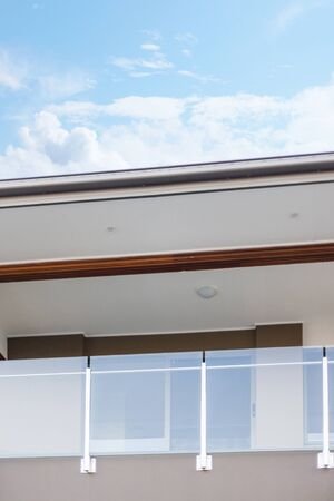 Stylish glass balcony rails, covered by the terrace and with a beautiful view of the sky.
