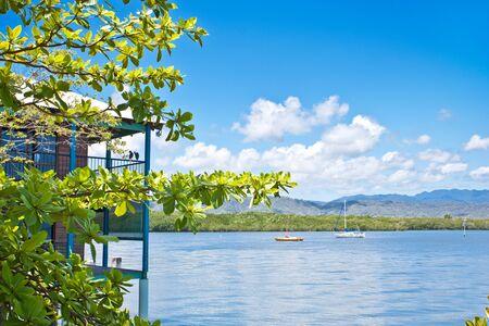A beautiful coastal landscape with a beach house and sea
