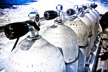 Oxygen tanks for divers lined-up on the yacht 写真素材
