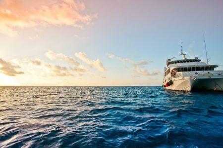 A small cruise ship sailing on the sea