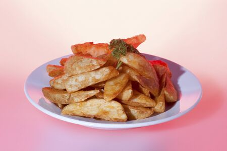 Toasted potatoes with shiny look, burger including meat and vegetable, very tasty look, background is pink color, dining table of a luxury hotel or house .