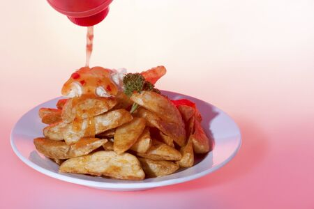 Honey mixed fried potatoes plate, burger including meat and vegetable, very tasty look, background is pink color, dining table of a luxury hotel or house .