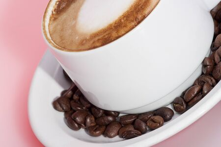Pure coffee and milk mixed mug, white color cup and background, colorized photograph including perfect lights, very tasty hot drink of luxury house.