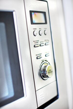 An electronic oven with multiple controls Stock Photo