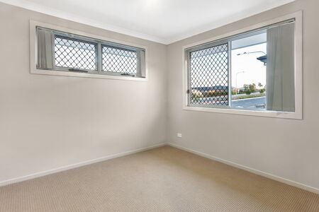 Carpeted bedroom with two windows