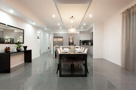 Beautiful dining room in new luxury house. Large modern dining table in contemporary kitchen