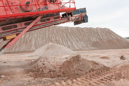 Crushing machinery working on the open pit quarry