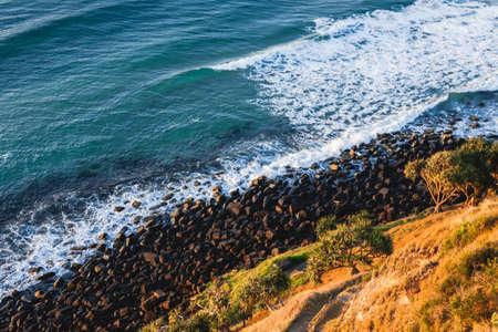 Oceran waves breaking on the rocky beach