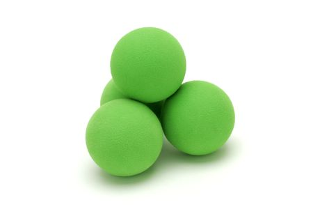 Isolated shot of four green balls.