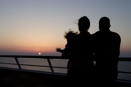 A nice shot of a young family enjoying a last sunset on a wonderful Caribbean cruise. photo