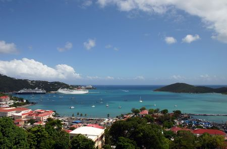 Cruise ships are docked at the port in St Thomas in the Caribbean on a beautiful sunny day.