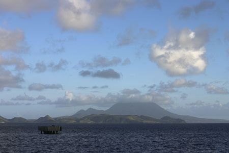 Nevis Peak, a volcanic Caribbean island and port on a beautiful, cloudy day. Stock Photo - 2510952