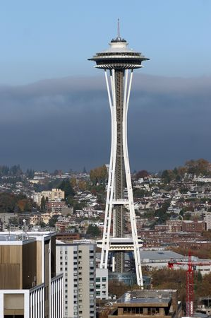 Close up of the Space Needle in downtown Seattle during a cloudy, Fall afternoon.