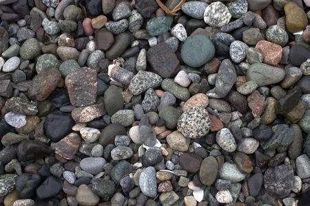 Colored pebbles on the edge of a lake. Imagens - 2511084