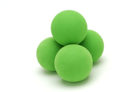 covalent: Isolated shot of four green balls.