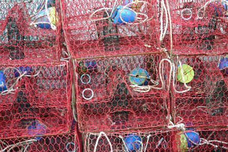 crab pots: A stack of crab pots at a commercial fishing dock.  Stock Photo