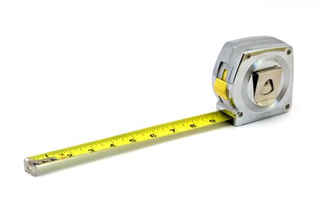 Isolated shot of a tape measure against a white background. Stock Photo