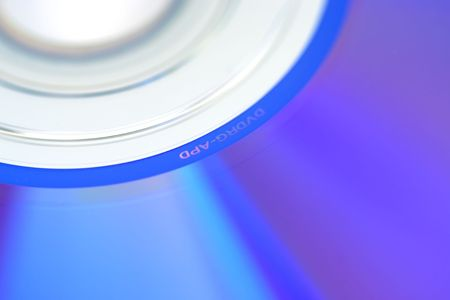 An abstract shot of a DVD suitable for use as a background. Stock Photo