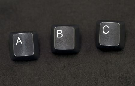 Isolated shot of computer keyboard keys on a black background.