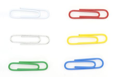 A variety of paperclips shot against a white background.
