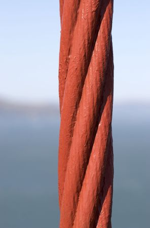 A shot of a supporting cable of the Golden Gate Bridge. Stock Photo