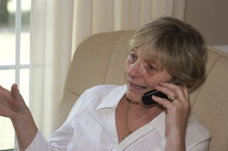 Close in shot of a senior woman talking on a cellphone. Stock Photo