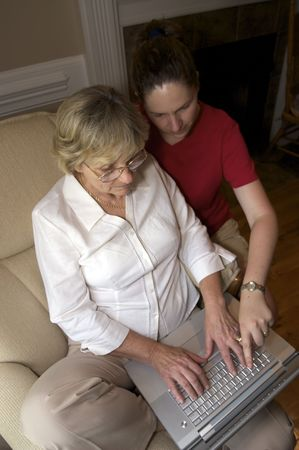 Close in shot of a woman collaborating over a laptop. Stock Photo