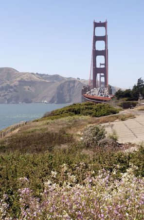 A shot of the Golden Gate Bridge taken from the path to Baker Beach. Stock Photo
