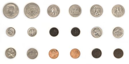 A studio isolation shot of a collection of used american coin currency.