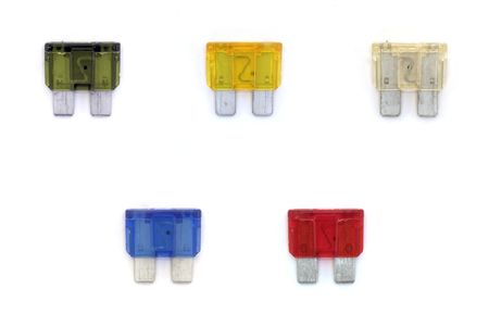 A studio isolated shot of a collection of automobile fuses. Stock Photo