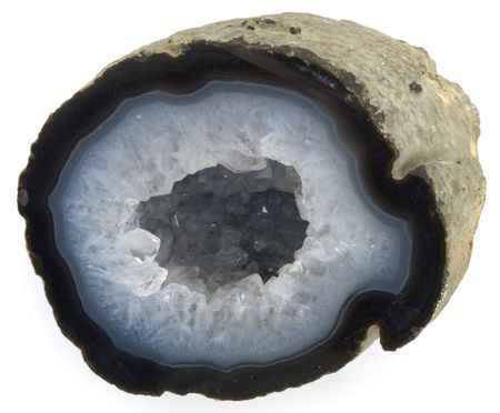 A studio close up shot of a blue agate rock half. Stock Photo