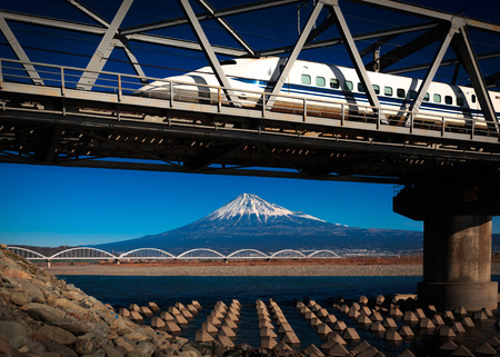 bullet train: Fuji and a bullet train crossing the bridge on the river in japan Stock Photo